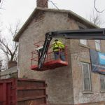 Workers restoring the side of the Grant-Sawyer Home - Grove City, OH