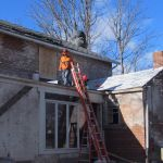 Workers at the back of the Grant Homestead House - Grove City, OH