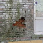 A hole in the brick wall of the Grant-Sawyer Home - Grove City, OH
