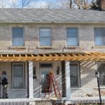 Workers restoring the front of the Grant-Sawyer Home - Grove City, OH