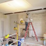 Installing drywall at the Grant Homestead House