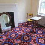 Carpeted room with a fireplace at the Grant-Sawyer Home